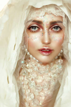 photomanipulation: Portrait of a young beautiful woman with big eyes. A princess. Doll.