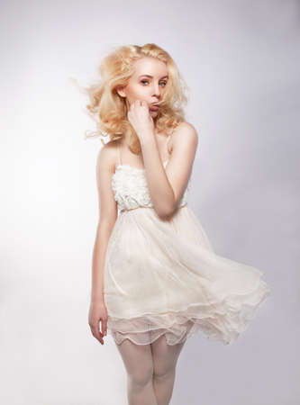 Young beautiful woman in a light dress. Motion. photo