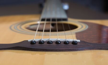 strings: Guitar - tailpiece with strings. Soft focus put only on tailpiece. Stock Photo
