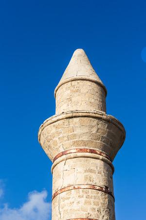 caesarea: Bosnian mosque in National historical park Caesarea, Israel. On blue sky background. Stock Photo
