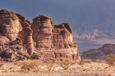 timna: Timna Park, Israel, Arava desert near Eilat. Red rocks on the mountains background. Stock Photo