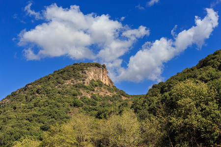 nahal: Mount with rock on the blue sky background. River (nahal) Kziv, Israel, Nature reserve.