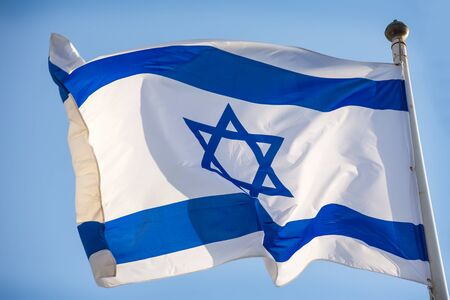 magen david: Israel official flag, blue white with magen david on the blue sky background. Stock Photo