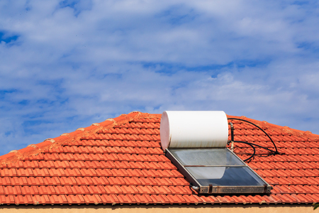 solar heating: Solar heating system on the tile roof. Eco friendly system. Israel. Middle east. Stock Photo
