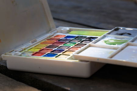paintbox: Paint-box on the wooden table. Soft focus with small DoF.