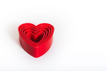 each: Red hearts in each other on white background - five pieces.