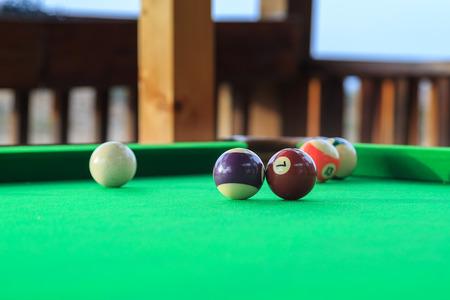 billiards halls: Billiard balls on the green pool table. Small amount of focus isolates number seven ball.
