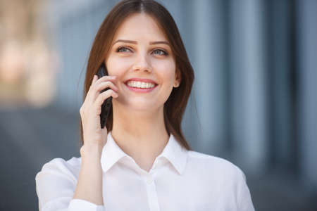 Smiling young girl talking on the mobile phone
