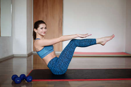 A young woman in sports clothes, doing yoga, Pilates in the gym. Exercise corner Stockfoto