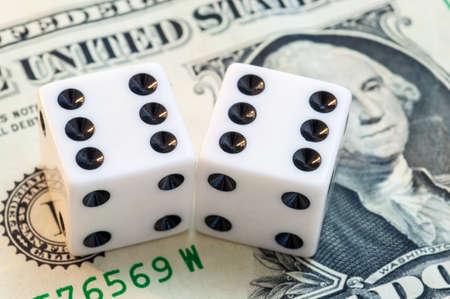 cash money: Close up of white dice and dollar cash money