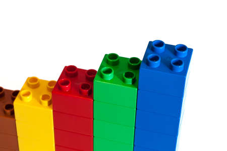 yellow lego block: Growing bar chart from color toy blocks isolated on white background
