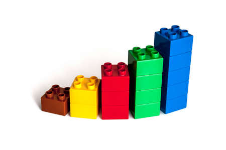 red building blocks: Growing bar chart from color toy blocks isolated on white background