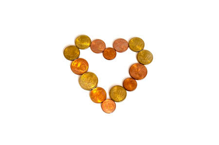nickle: Heart created with coins on white background Stock Photo