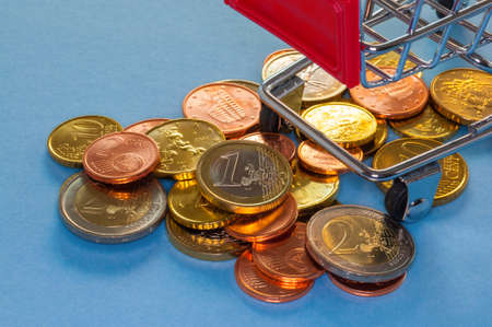 purchasing power: A shopping cart with euro coins, symbolic photo for purchasing power and consumption
