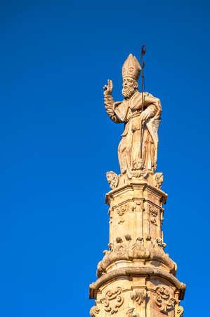obelisk stone: Sculpture of St Oronzo. Ostuni, Apulia, Italy. Stock Photo