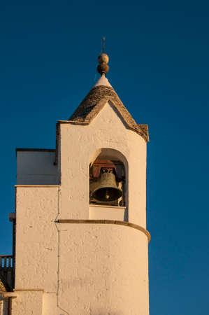 Church in the town of Alberobello, a beautiful white village in Apulia, Italy.
