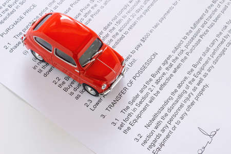 selling service: red toy car on contract Stock Photo