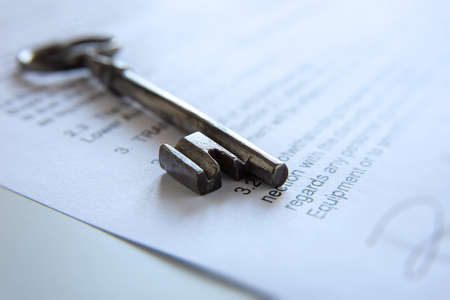 agency agreement: Old key on a contract Stock Photo