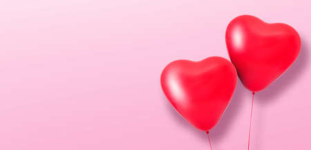 Love heart balloons on pink background Banque d'images