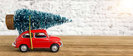 Red Car Carrying A Christmas Tree