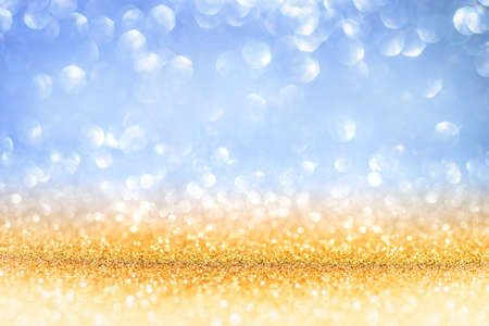 Golden Glitter On Shiny backdrop With Blurred Lights
