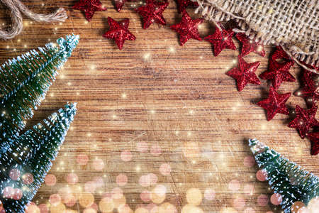 Christmas background with trees and decorations on wooden board Stock Photo