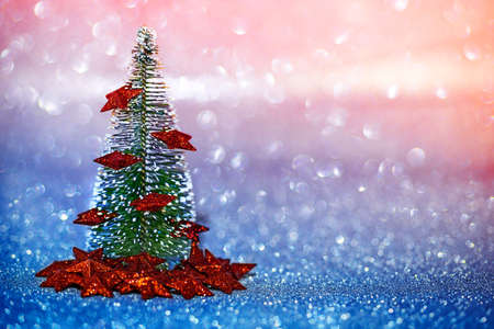 Christmas Tree with glitter background and bokeh effect