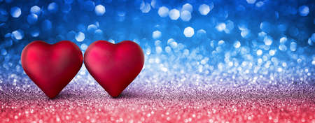 Valentines Card - Shiny Two Hearts On Blue and Red Background Stock Photo