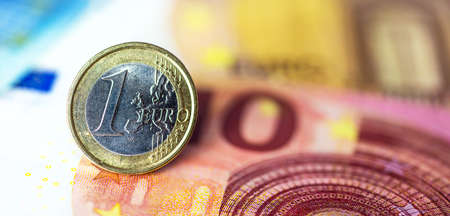 One Euro Coin on banknotes Stock Photo