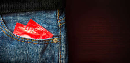 Concept Male Contraception Condom in Jeans Pocket