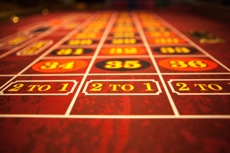 Roulette table with red felt Stock Photo