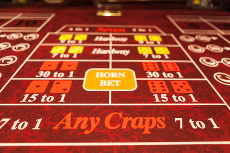Craps table with red felt Stock Photo - 26810212