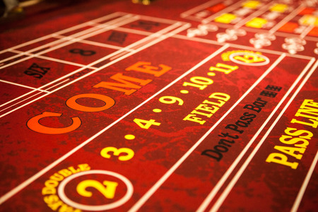 Craps table with red felt Stock Photo