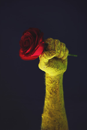 Fist with red rose, old propaganda poster. They shall not pass