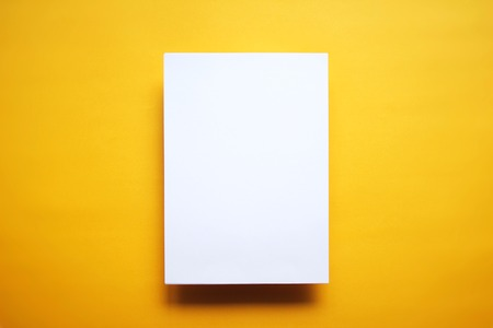 white paper: Empty white paper sheet isolated on yellow background