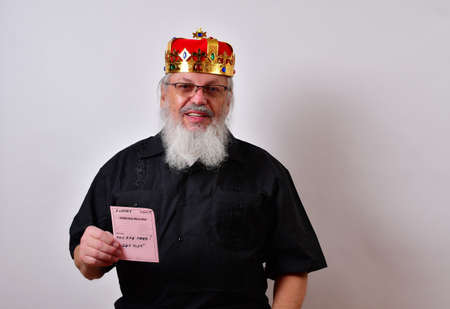 Sneering tyrant of a boss fires an employee. Sadistic old man with a golden crown and black guayabera shirt and long white beard.