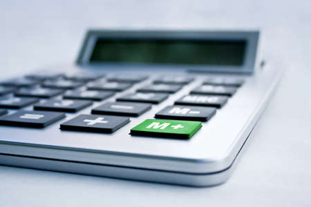 calculator close up with a green m+ button