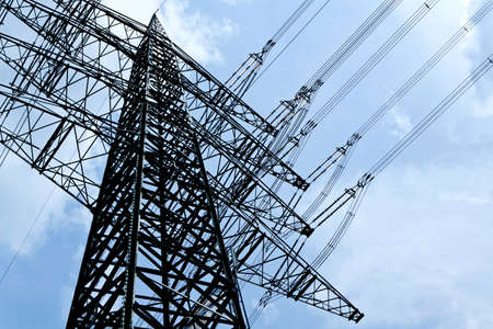 energy management: high voltage tower on a blue sky background Stock Photo