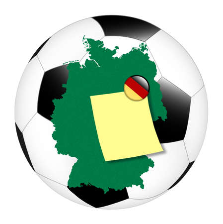 football contains the map of germany and a pinned note Stock Photo