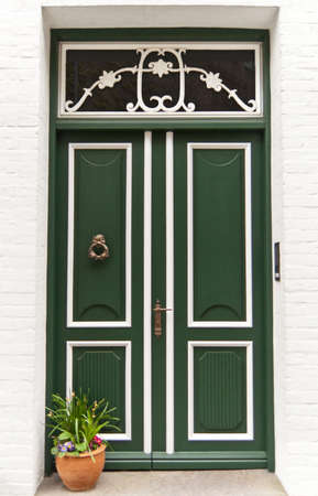 Front door of a historical german white brick house