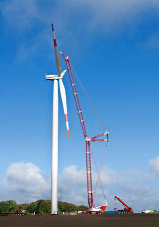 wind force wheel: Wind turbine under construction with a crane