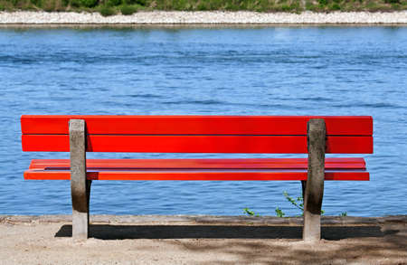 Park bench on the river Rhine Stock Photo