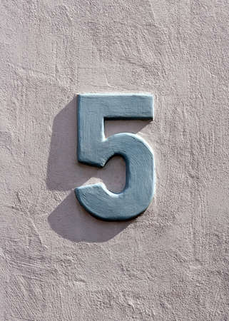 Number 5 on a wall