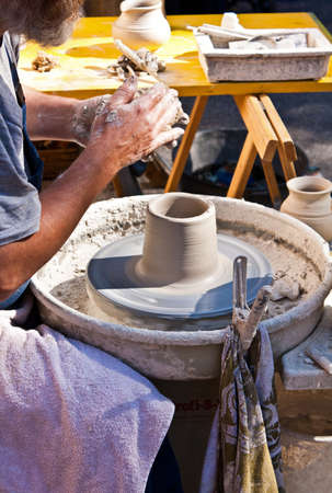 finger shape: Pottery manufacture on a Potters wheel Stock Photo