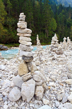 Pile of stones beside a river Stock Photo