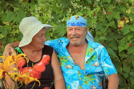 A couple of elderly people at the dacha rests                     photo