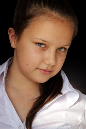 Portrait of a young girl on a black background photo