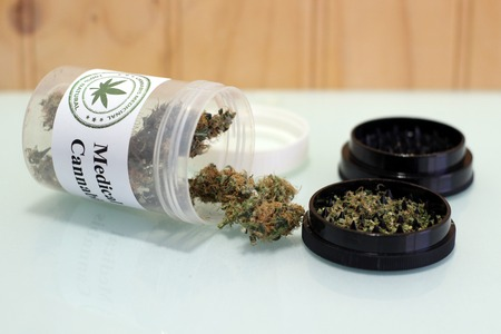 Medicinal cannabis buds stuck in a jar. A therapeutic way to heal the pains Banco de Imagens - 113438956