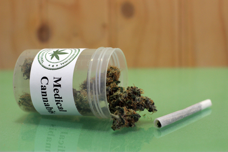 Medicinal cannabis buds stuck in a jar. A therapeutic way to heal the pains
