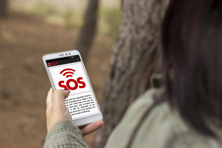 Girl lost in the forest asks for help through an application with her smart phone
